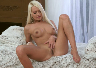 Sweet blond chick Lina Love rubs her tight shaved muff