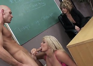 Lengthy haired blond Julie Cash is a slutty breasty student girl. Curvy large titted girl with soaked as gets her hairless strong cum-hole banged hardcore style right in front of curious older woman in the classroom.