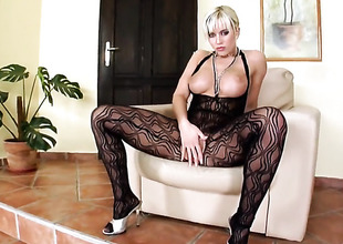 Cindy Dollar with gigantic breasts and trimmed muff stroking her bush