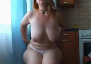 Fat girl plays with a toy in the kitchen and in the shower