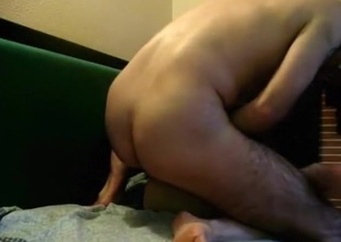 Nerdy glassed milf has sex with her spouse on the couch