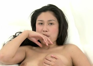 Alluring Oriental beauty Ming caresses her ideal shaven snatch