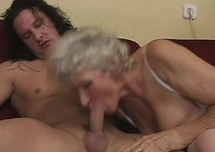 Slutty granny wants to be a schoolgirl another time and has a young dick to help her out