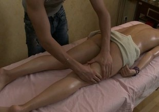 Nell gets an oiled up massage and her masseuse gets his bone in her