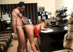 Feisty black chick gets her hairy snatch filled by her hung boss