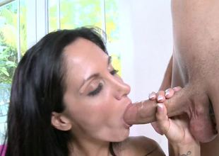 Milf with large natural tits is seen placing her hungry mouth on a knob