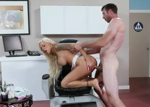 A blond that has huge tits is getting her fur pie stretched