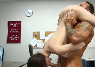 A sexy bitch is getting her pussy licked on the desk in the class