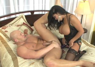 Darksome haired whore with a strap-on fucks her freaky partner so hard