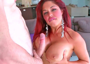 Inviting red haired Latina Helen Cielo rides a large hard dick