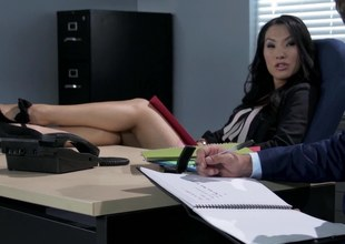 A hot Oriental slut is getting fucked in the office by her employee