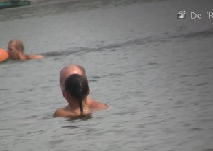 Aged women completely undressed sunbathing on the beach
