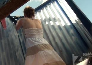 Beautiful cutie in pretty dress undressing in the cabin