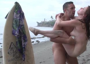 Two people are nude on the beach and they are doing kinky things