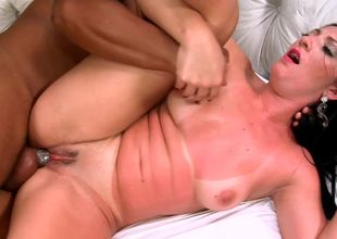 A large black guy penetrates a hottie with prominent tan lines