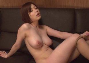 Vivacious Japanese hottie in latex underware rides a stiff pecker cowgirl pose