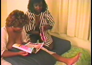 Ebony babes have a fun licking each other in advance of being nailed in a FFM clip