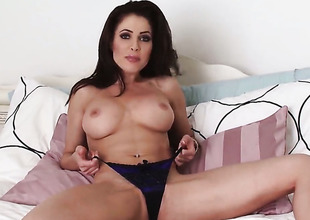 Erika Jordan opens her legs to fuck her moist slit with toy