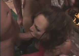 Slut in a red body stocking gets wrecked by a group of rough dudes