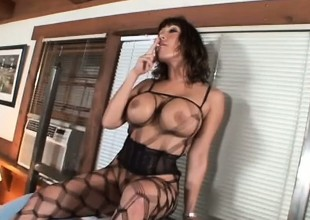 Voluptuous Asian mamma in fishnets reveals her great cock sucking skills