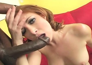 Gorgeous redhead exposes her body and then has fun with a black stud