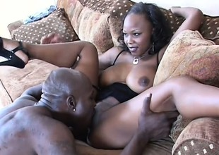Darksome skinned beauty with big boobs takes a huge black dick in her a-hole