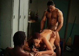 Short haired ebony girl gets banged by two black guys in the locker room