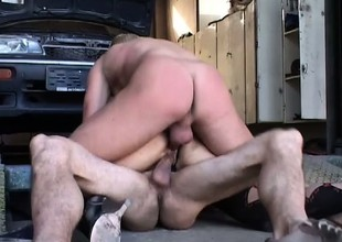Hung mechanics pound the horny milf's holes at once in the garage