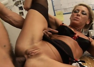 Nasty blond secretary feeds her excitement for black wang in the office