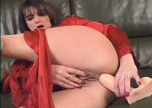 Vicious milf in red blouse works out her ass with dildo and gets banged later