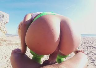 Golden-haired with sizable boobs and a massive ass bonks on the beach