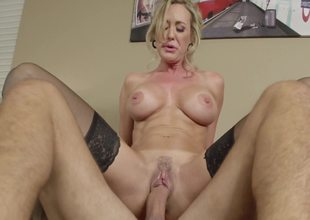 A blond milf with large titties and a fit tummy is getting fucked