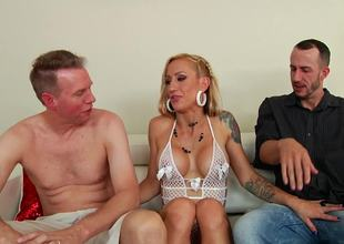 Two chaps are fucking a horny milf in her cunt and in the ass