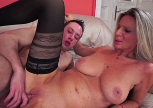 Granny with long hair is feeling a large youthful guy inside her snatch