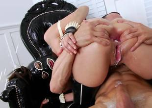 A hottie with pigtails is getting a dick shoved into her sexy mouth