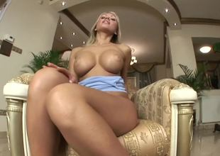 A blonde with big pointer sisters is opening up her cunt to have fun